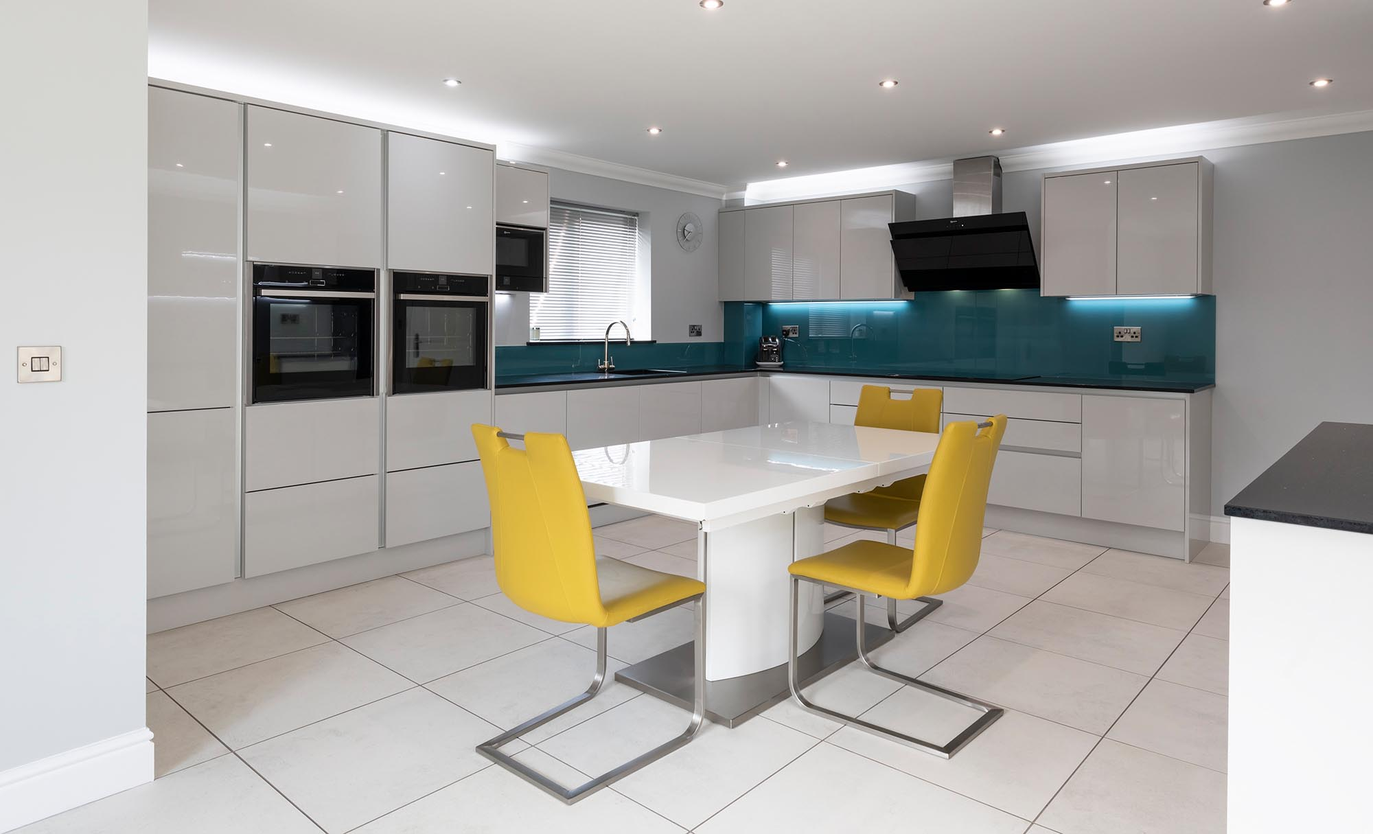 Portishead Kitchens Zola Gloss Light Grey Kitchen for a home in Portishead