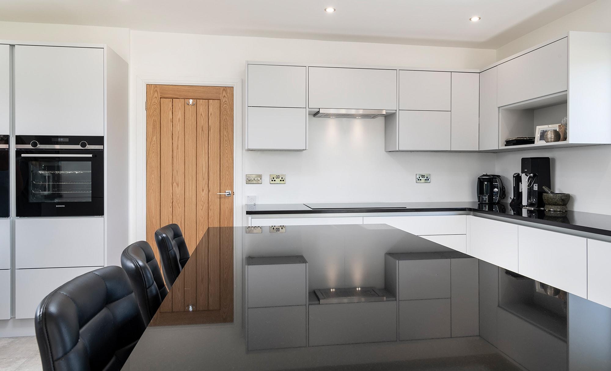 Portishead Zola Matte kitchen with black worktop