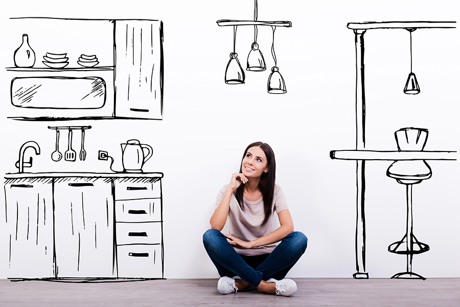 A woman day dreaming about when how long she can expect a new kitchen from the Kitchen Stori range to take